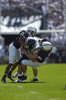 01 September 2007:  Penn State's Tony Davis (11) and Sean Lee (45) make a tackle..The Penn State Nittany Lions defeated the Florida International Golden Panthers 59-0 September 1, 2007 at Beaver Stadium in State College, PA..