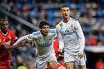Cristiano Ronaldo of Real Madrid (R) and Jesus Vallejo of Real Madrid (C) fights for position during La Liga 2017-18 match between Real Madrid and Sevilla FC at Santiago Bernabeu Stadium on 09 December 2017 in Madrid, Spain. Photo by Diego Souto / Power Sport Images