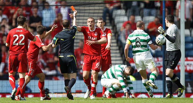 Andrew Considine trips Gary Hooper in box for a penalty kick and is shown a straight red card by referee Wilie Collum