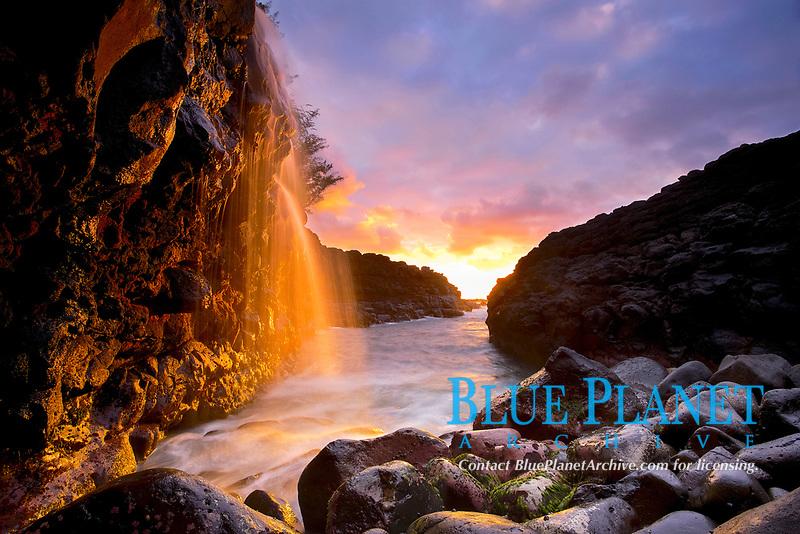 ephemeral waterfalls near Queen's Bath at sunset, Kauai, Hawaii, USA, Pacific Ocean