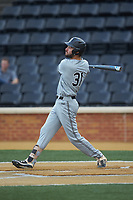 Alex Mardiney (31) of the Davidson Wildcats follows through on his swing against the Wake Forest Demon Deacons at David F. Couch Ballpark on May 7, 2019 in  Winston-Salem, North Carolina. The Demon Deacons defeated the Wildcats 11-8. (Brian Westerholt/Four Seam Images)