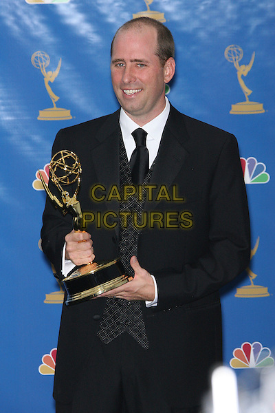 GREG GARCIA.Press Room - 58th Annual Primetime Emmy Awards held at the Shrine Auditorium, Los Angeles, California, USA, .27 August 2006..emmys half length trophy award.Ref: ADM/ZL.www.capitalpictures.com.sales@capitalpictures.com.©Zach Lipp/AdMedia/Capital Pictures.
