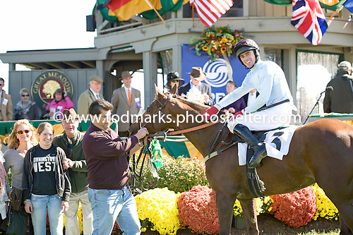 Lonesome Nun, jockey Brian Crowley, and trainer Bruce Miller in the winner's circle at Great Meadow in October.