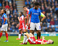Ellis Harrison of Portsmouth jokes with Mark Byrne of Gillingham after clashing during Portsmouth vs Gillingham, Sky Bet EFL League 1 Football at Fratton Park on 12th October 2019
