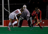 Katie O'Donnell (16) of Maryland takes a shot that is blocked by Bri Doak (3) of Ohio State during the NCAA Field Hockey Championship semfinals in College Park, MD.  Maryland defeated Ohio State, 3-1.