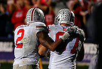 Ohio State Buckeyes defensive lineman Joey Bosa (97) gets a pat on the back from Ohio State Buckeyes linebacker Ryan Shazier (2) after Bosa scores a touchdown in the fourth quarter of their game at Ryan Field in Evanston, IL on October 5, 2013. Columbus Dispatch photo by Brooke LaValley)