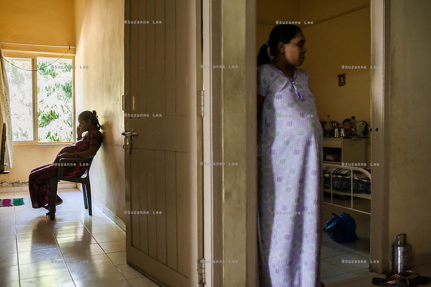 Surrogates pass their time talking on their mobile phones or watching daily happenings in the surrogates hostel on the 3rd floor of Dr. Nayana Patel's Akanksha IVF and surrogacy center in Anand, Gujarat, India on 11th December 2012. Photo by Suzanne Lee / Marie-Claire France