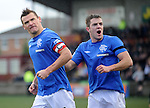 Lee McCulloch scores the opener from the penalty spot and celebrates with Andy Little