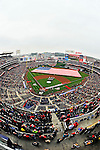31 March 2011:  With the teams lining the basepaths, the United States Navy Marching Band plays the National Anthem on the infield, while a giant US Flag covers the outfield during the pre-game ceremonies of Opening Day, prior to a game between the Washington Nationals and the Atlanta Braves at Nationals Park in Washington, District of Columbia. The Braves shut out the Nationals 2-0 to open the 2011 Major League Baseball season. Mandatory Credit: Ed Wolfstein Photo