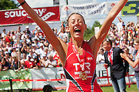 Chrissie Wellington breaks a world record and wins first female place at the Challenge Roth Ironman Triathlon, Roth, Germany, 10 July 2011