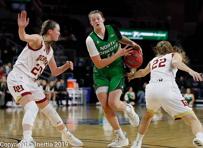 SIOUX FALLS, SD - MARCH 10: Lexi Klabo #34 loses handle of the ball in between Denver's Madison Nelson #23 and Samantha Romanowski #22 at the 2019 Summit League Basketball Tournament at the Denny Sanford Premier Center in Sioux Falls. (Photo by Dick Carlson/Inertia)