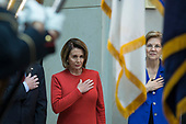 United States House Minority Leader Nancy Pelosi (Democrat of California), left, and US Senator Elizabeth Warren (Democrat of Massachusetts), right stand at attention as the United States National Anthem is played during a ceremony dedicating a chair in the United States Capitol Building to honor United States soldiers labeled as 'Prisoners of War' or 'Missing in Action' at the United States Capitol Building in Washington, D.C. on November 8th, 2017. <br /> Credit: Alex Edelman / CNP