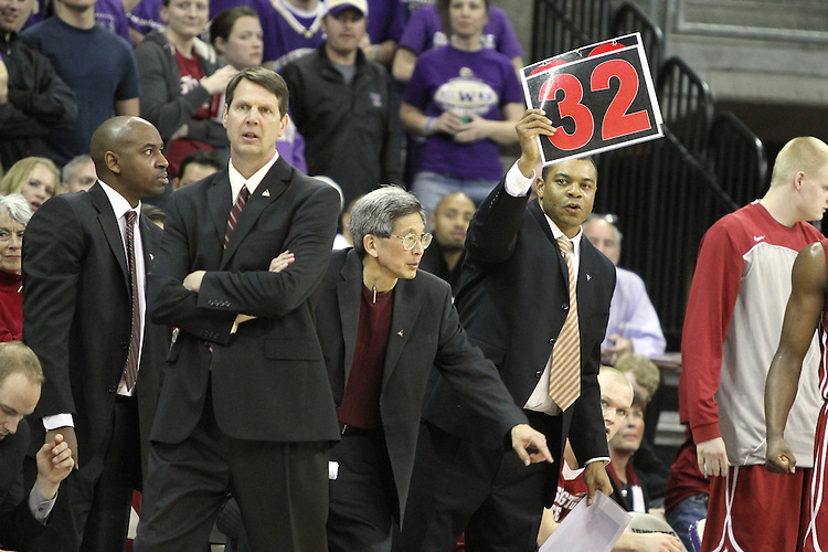 The Washington State University coaching staff, Curtis Allen, Ken Bone, Jeff Hironaka, and Ben Johnson, work the sidelines during the Cougars 80-69 road victory over arch-rival Washington at the Alaska Airlines Arena in Seattle, Washington, on February 27, 2011.  With the victory, the Cougars swept the regular season series from the Huskies, two games to none.
