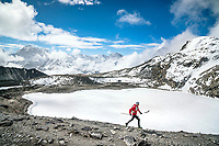 A trail runner on the first pass, Kongma La, above Chukhung while starting the 3 Passes tour. Khumbu Valley, Nepal.