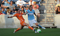 Sky Blue FC defender Danielle Johnson (15) slide tackles the ball away from Chicago Red Star forward Kosovare Asllani (10).  The  Chicago Red Stars defeated the Sky Blue FC 2-0 at Toyota Park in Bridgeview, IL on July 10, 2010.   The  Chicago Red Stars defeated the Sky Blue FC 2-0 at Toyota Park in Bridgeview, IL on July 10, 2010.