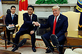 United States President Donald J. Trump shakes hands  with Prime Minister of Japan Shinzo Abe in the Oval Office of the White House on June 7, 2018 in Washington, DC.<br /> Credit: Yuri Gripas / Pool via CNP
