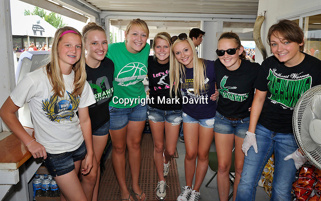Members of the Southeast Warren's Junior Varsity basketball team helped prepare and serve food in the Warren County Cattlemen's Association booth. The Cattlemen's group shares part of the proceed with the team. The team is planning to buy new jerseys with their earnings. Team members include, from left: Brooke Seuferer, Sarah Nutting, Amanda Williams, Haley Seuferer, Brandy Putz, Sydney Steenhoek and Amy Williams. To request a print of this image go to: http://tinyurl.com/c45dc7s