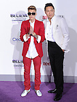 LOS ANGELES, CA - December 18: Justin Bieber and Jon M. Chu arrives at Justin Bieber`s Believe World Premiere held at The Premiere House at Regal Cinemas L.A. Live in Los Angeles, California on December 18,2013                                                                               © 2013 Hollywood Press Agency