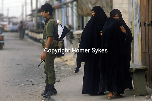 Rafah Israel 1982. Israeli soldier,  Palestinian women. New check point has just been set up