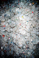 RECYCLING PLANT<br /> Sloatsburg, NY<br /> Large pile of HDPE plastic items. The recycling process for plastic normally involves cleaning it, shredding it into flakes, then melting the flakes into pellets. The pellets are melted into a final product.