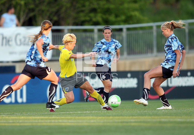 Allie Long #9 of the Washington Freedom, playing in a special camouflage uniform challenges Lori Lindsey #6 of the Philadelphia Independence during a WPS match on military appreciation night at the Maryland Soccerplex in Boyds, Maryland on May 30 2010. Freedom won 2-1.