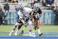 Washington, DC - February 23, 2019: Georgetown Hoyas James Reilly (33) and Towson Tigers Alex Woodall (3) fights for the ground ball during game between Towson and Georgetown at  Cooper Field in Washington, DC.   (Photo by Elliott Brown/Media Images International)