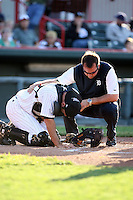 June 10th 2008:  Trainer Chris McDonald of the Erie Seawolves, Class-AA affiliate of the Detroit Tigers, checks on Max St. Pierre after being hit with a foul ball during a game at Jerry Uht Park in Erie, PA.  Photo by:  Mike Janes/Four Seam Images