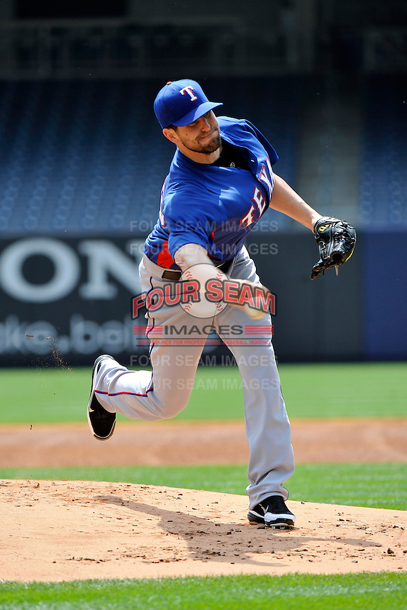 Texas Rangers pitcher Darren O'Day #56 during a pre-game work out prior to game against the New York Yankees at Yankee Stadium on June 16, 2011 in Bronx, NY.  Yankees defeated Rangers 3-2.  Tomasso DeRosa/Four Seam Images