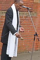 Yuroba High Priest Professor Gus John performing a libation ritual at the the Malcom X, Marshall Street, Smethwick, Blue Plaque unveiling