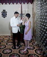 Young man lighting a  cigarette for woman outside the ballroom of the Kings Grant Hotel.