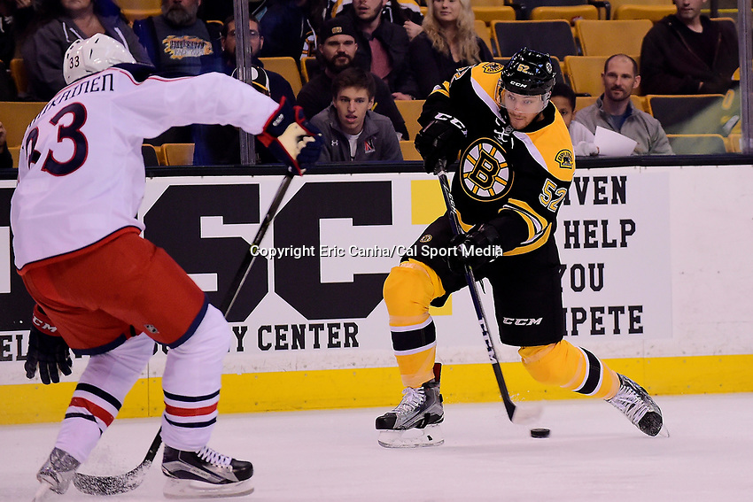 Monday, September 26, 2016: Boston Bruins center Sean Kuraly (52) shoots the puck during the NHL game between the Columbus Blue Jackets and the Boston Bruins held at TD Garden, in Boston, Massachusetts. Eric Canha/CSM