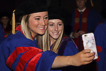 Graduates congregate backstage before the DePaul University College of Law commencement ceremony, Sunday, May 14, 2017, at the Rosemont Theatre in Rosemont, IL, where some 240 students received their Juris Doctors or Master of Laws degrees. (DePaul University/Arielle Toub)