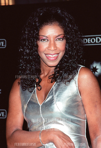 "07NOV99: Pop star NATALIE COLE at Beverly Hills' Rodeo Drive's ""Tribute to Style: Millennium Exhibition & Concert"" in aid of the Entertainment Industry Foundation..© Paul Smith / Featureflash"