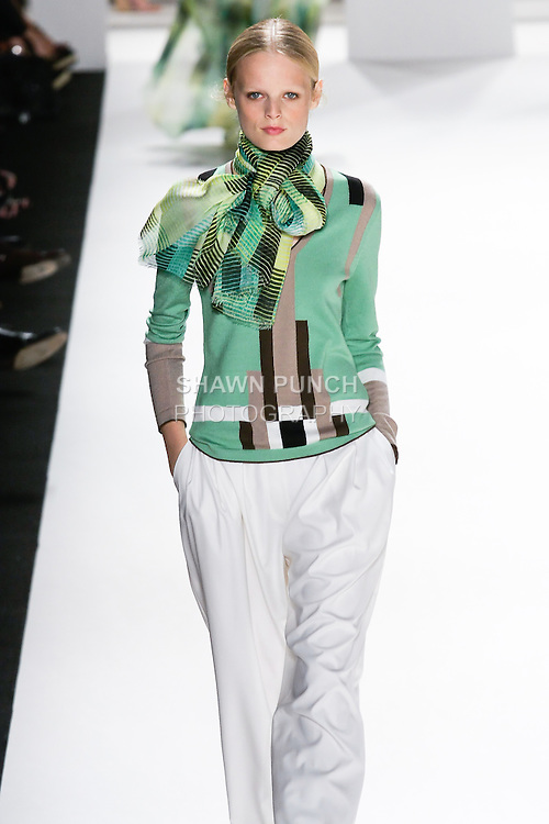 Hanne Gaby Odiele walks the runway in a peppermint, taupe, off white and sepia knit, off white silk crepe pleated pant, canary yellow, grass green, and black sripe print silk and modal scarf for the Carolina Herrera Spring 2012 fashion show, during Mercedes-Benz Fashion Week Spring 2012.