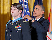 United States President Barack Obama awards William Swenson, a former active duty Army Captain, the Medal of Honor for conspicuous gallantry in the East Room of the White House in Washington, D.C. on October 14, 2013.  Captain Swenson accepted the Medal of Honor for his courageous actions while serving as an Embedded Trainer and Mentor of the Afghan National Security Forces with Afghan Border Police Mentor Team, 1st Battalion, 32nd Infantry Regiment, 3rd Brigade Combat Team, 10th Mountain Division, during combat operations in Kunar Province, Afghanistan on September 8, 2009.<br /> Credit: Ron Sachs / CNP