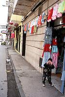 Terzigno (NA)    Aprile 2005.La via principale di Terzigno, con i negozi gestiti da cinesi.La città è il fulcro dell'imprenditoria tessile cinese..Terzigno (NA) April 2005    .The principal street of Terzigno, with the shops managed by chinese. The  city is the textile hub of the Chinese.