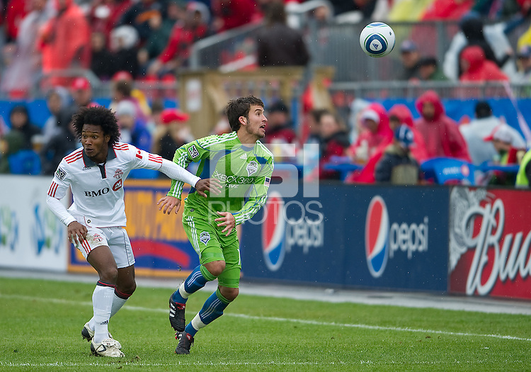 25 April 2010: Seattle Sounders defender Nathan Sturgis #12 and Toronto FC midfielder Julian de Guzman #6 in action during a game between the Seattle Sounders and Toronto FC at BMO Field in Toronto..Toronto FC won 2-0....