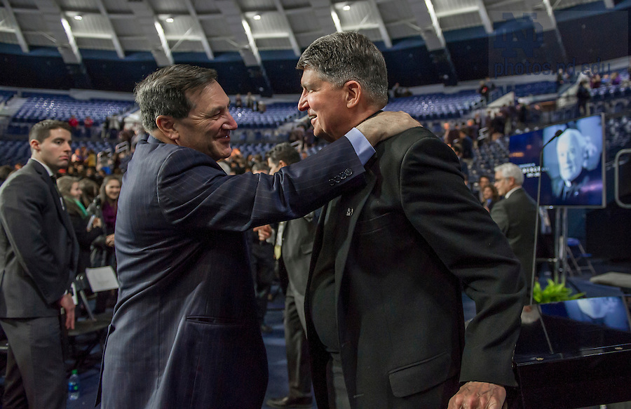 Mar. 4, 2015; Senator Joe Donnelly and Rev. Paul Doyle, C.S.C., chat after the tribute ceremony in the Purcell Pavilion to honor the life of the late President Emeritus Rev. Theodore M. Hesburgh, C.S.C. (Photo by Barbara Johnston/University of Notre Dame)