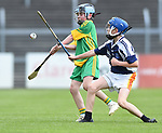 Oisin Close of Kilkishen/O Callaghan's Mills in action against Joe Murnane of Bridgetown during their Schools Division 5 final at Cusack Park. Photograph by John Kelly