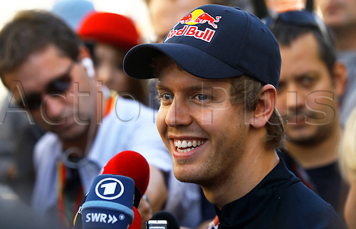07.10.2010 German driver Sebastian Vettel of Red Bull Racing gives an interview at Suzuka Circuit in Suzuka, Japan. The 2010 Formula 1 Japanese Grand Prix is held on 10 October.