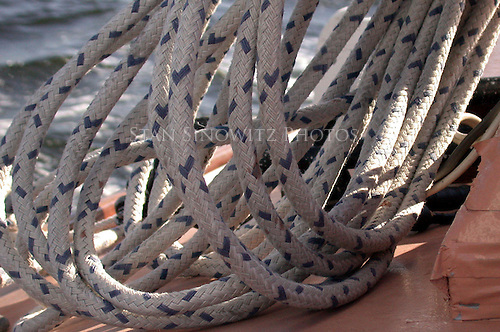 A coil of rope is the Main Sail halyard when the sail is hoisted.