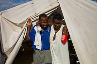 Port Au Prince, Haiti, Jan 23 2010.Islaine Celmé, 38, who lost her right hand and left arm in the disaster is comforted by her husband Carlo Celmé, 41; they are both displaying a very positive spirit in front of their personal tragedy.The Belgian B-Fast team has set up a field hospital in Delmas 33; 2 surgeons treat victims of heavy traumatisms..