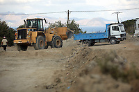 Pictured: A digger loads soil to a tipper lorry at the second site in Kos, Greece. Thursday 13 October 2016<br />