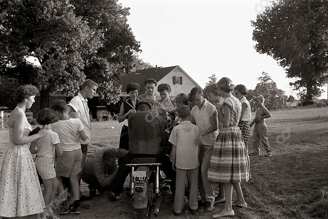 """In a Marlon Brando outfit"" at his parent's home, signing autographs for the neighborhood; Memphis, Tennessee, USA, July 4, 1956"