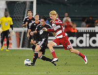 DC United midfielder Santino Quaranta (25) shields the ball agaisnt FC Dallas Brek Shea (20) .  FC. Dallas defeated DC United 3-1 at RFK Stadium, Saturday August 14, 2010.