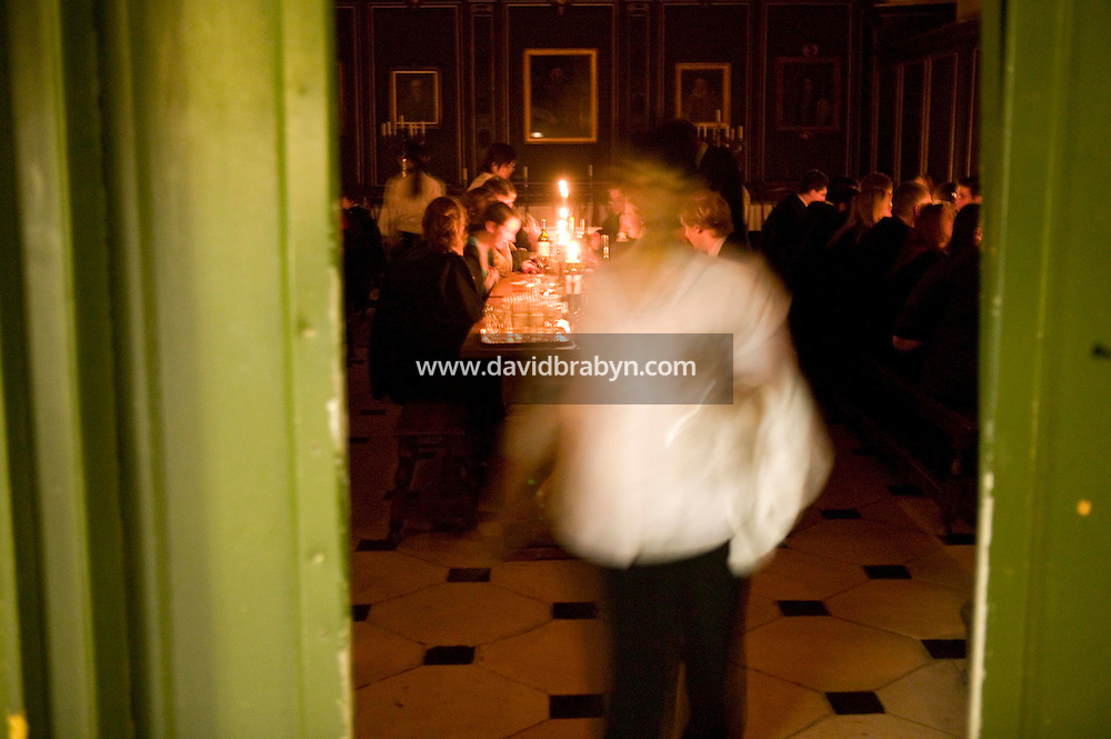 Students remain in the formal dinning hall to chat after the Fellows departure at Magdalene College in Cambridge, United Kingdom, 11 March 2007.