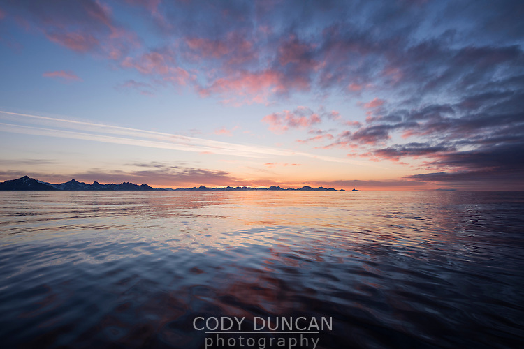 Dawn over calm sea near Tasiilaq, east Greenland