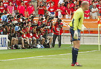 International press photographers line up two rows deep to catch the action--Brad Friedel in foreground. The USA tied South Korea, 1-1, during the FIFA World Cup 2002 in Daegu, Korea.