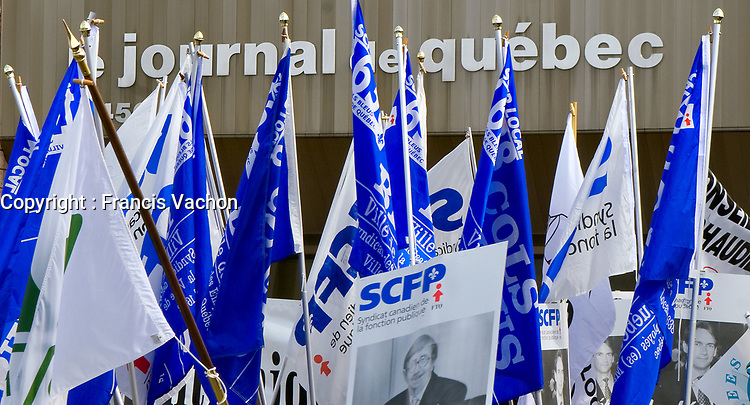 Flags are raised in front of the Quebecor owned Journal de Quebec newspaper office during  protest for the one-year mark of the lockout in Quebec city April 20, 2007.<br /> <br /> PHOTO :  Francis Vachon - Agence Quebec Presse