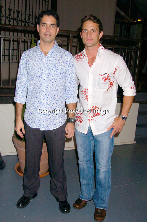 Javier Morga and David Fumero..at ABC Casino Night on October 7, 2004 at The Lighthouse..at Chelsea Piers. ..Photo by Robin Platzer, Twin Images